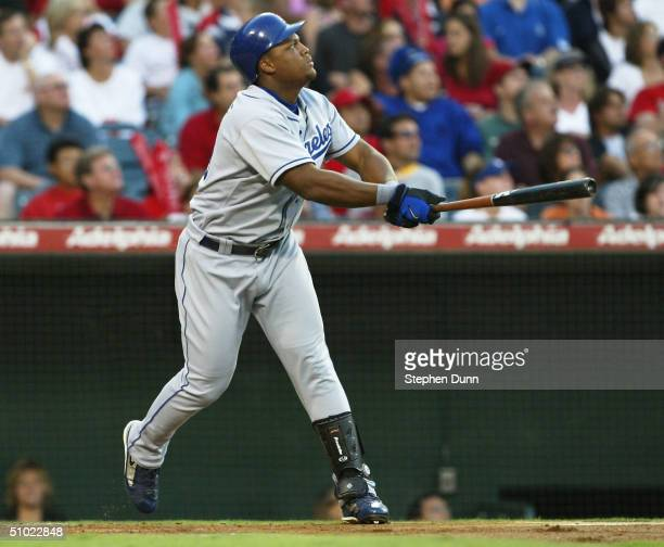 Adrian Beltre of the Los Angeles Dodgers hits a two run home run in the first inning against the Anaheim Angels on July 3 2004 at Angel Stadium in...