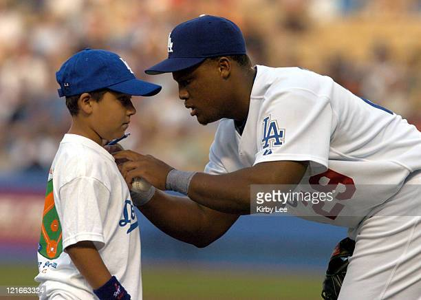 Adrian Beltre of the Los Angeles Dodgers signs autograph for fan before game against the Baltimore Orioles at Dodger Stadium on Tuesday June 15 2004