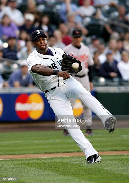 Adrian Beltre of the Seattle Mariners throws the ball to first base during a game against the Baltimore Orioles on July 14 2005 at Safeco Field in...
