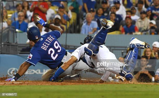 Adrian Beltre of the Texas Rangers beats the tag by Austin Barnes of the Los Angeles Dodgers to score a run on a single by Jurickson Profar of the...