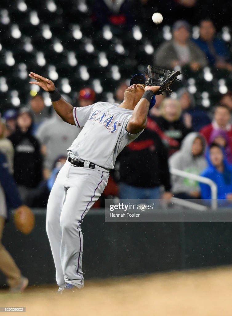 Adrian Beltre #29 of the Texas Rangers catches a pop up hit by Brian Dozier #2 of the Minnesota Twins during the eighth inning of the game on August 3, 2017 at Target Field in Minneapolis, Minnesota. The Rangers defeated the Twins 4-1.