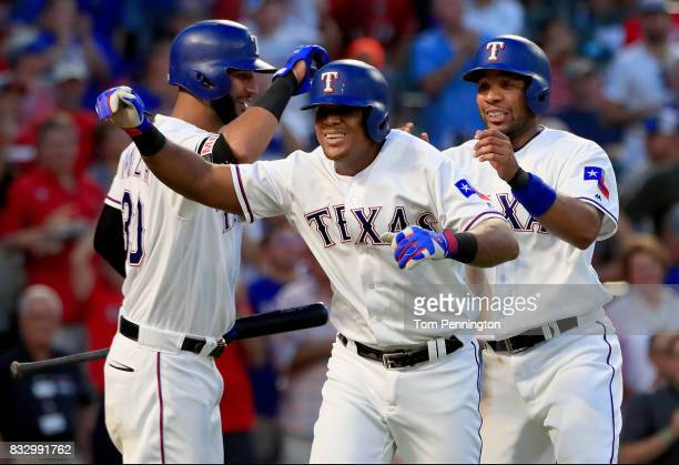 Adrian Beltre of the Texas Rangers celebrates with Nomar Mazara of the Texas Rangers and Elvis Andrus of the Texas Rangers after hitting a two run...