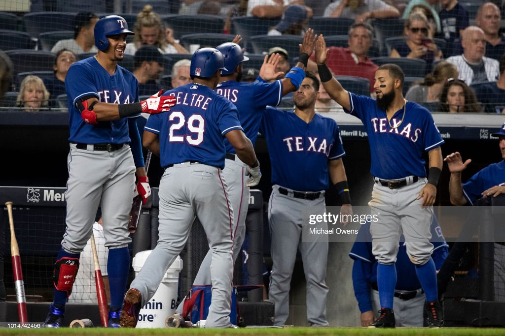 Adrian Beltre #29 of the Texas Rangers celebrates with teammates after hitting a homerun sending Elvis Andrus #1 of the Texas Rangers to scoring in the fourth inning against the during their game at Yankee Stadium on August 10, 2018 in New York City.