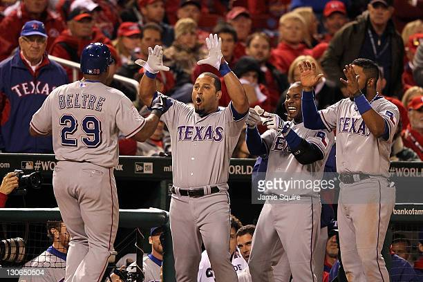 Adrian Beltre of the Texas Rangers celebrates with Yorvit Torrealba after hitting a solo home run in the seventh inning during Game Six of the MLB...