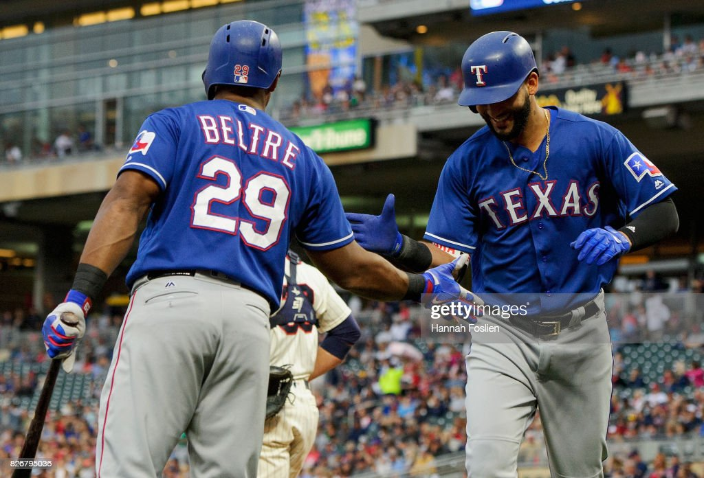 Adrian Beltre #29 of the Texas Rangers congratulates teammate Nomar Mazara #30 on a two-run home run against the Minnesota Twins during the first inning of the game on August 5, 2017 at Target Field in Minneapolis, Minnesota. The Rangers defeated the Twins 4-1.