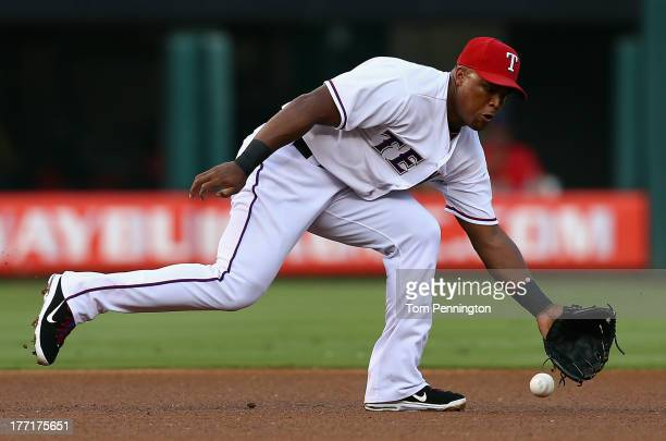 Adrian Beltre of the Texas Rangers dives to make the stop for the out on a line drive hit byJose Altuve of the Houston Astros in the top of the first...