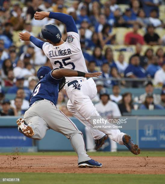 Adrian Beltre of the Texas Rangers fields a ball hit by Yasiel Puig of the Los Angeles Dodgers and tags out Cody Bellinger of the Los Angeles Dodgers...