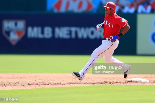 Adrian Beltre of the Texas Rangers hits a double against the Tampa Bay Rays in the bottom of the second inning at Globe Life Park in Arlington on...
