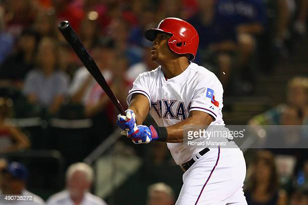 Adrian Beltre of the Texas Rangers hits a double in the third inning against the Detroit Tigers at Globe Life Park in Arlington on September 30 2015...