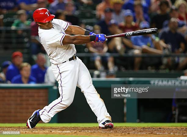 Adrian Beltre of the Texas Rangers hits a grand slam in the fifth inning against the Oakland Athletics at Globe Life Park in Arlington on August 15...