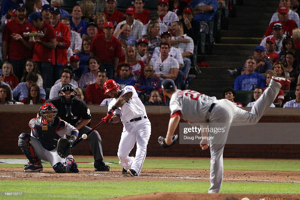 Adrian Beltre #29 of the Texas Rangers hits a solo home run in the sixth inning off of Chris Carpenter #29 of the St. Louis Cardinals during Game Five of the MLB World Series at Rangers Ballpark in Arlington on October 24, 2011 in Arlington, Texas.