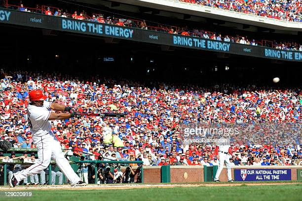 Adrian Beltre of the Texas Rangers hits an RBI double against the Detroit Tigers in the first inning of Game Two of the American League Championship...