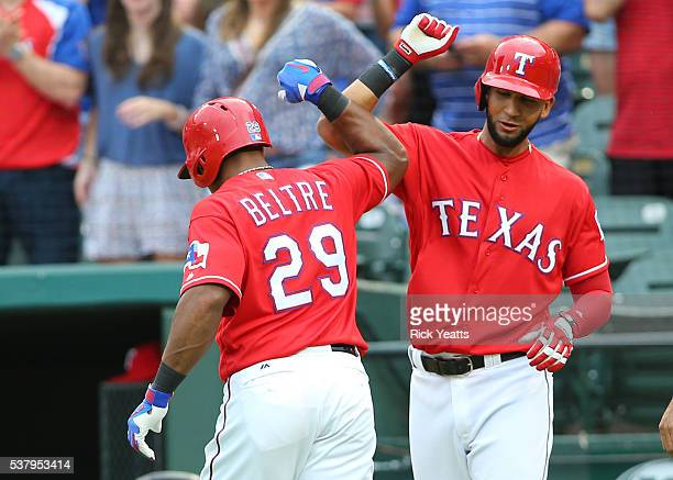 Adrian Beltre of the Texas Rangers is congratulated by Nomar Mazara after hitting a three run home run in the first inning at Globe Life Park in...