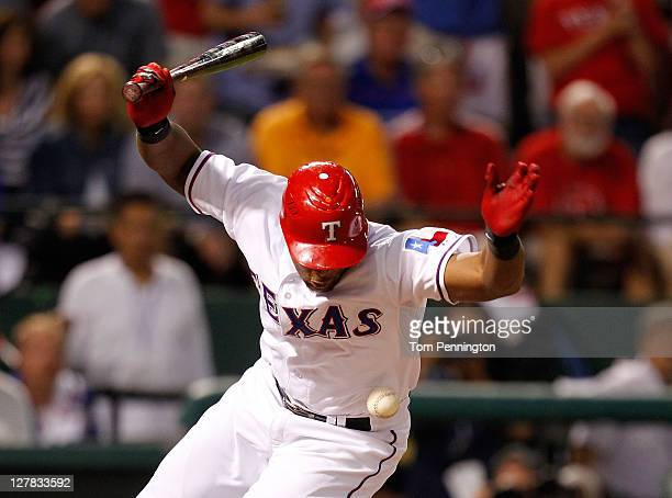 Adrian Beltre of the Texas Rangers is hit by a pitch from James Shields of the Tampa Bay Rays scoring Elvis Andrus in the fourth inning of Game Two...