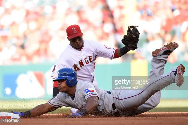 Adrian Beltre of the Texas Rangers is out at second base in the fourth inning against Erick Aybar of the Los Angeles Angels of Anaheim at Angel...