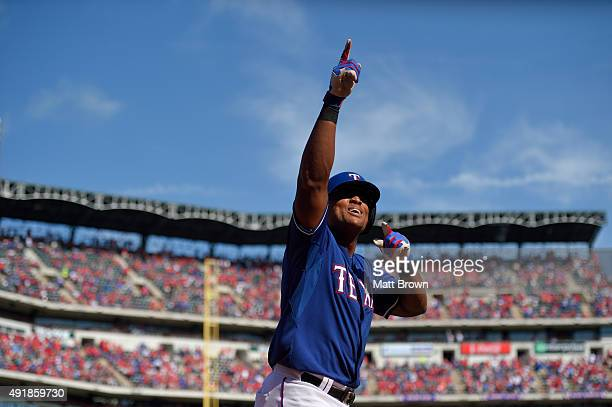Adrian Beltre of the Texas Rangers points upwards while celebrating after hitting a tworun home run during the fifth inning of the game against the...