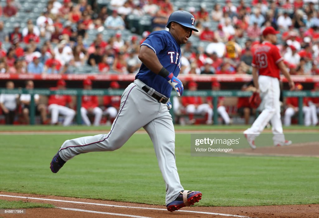 Adrian Beltre #29 of the Texas Rangers runs to first base on a two-run rbi double against pitcher Garrett Richards #43 of the Los Angeles Angels of Anaheim during the first inning of the MLB game at Angel Stadium of Anaheim on September 17, 2017 in Anaheim, California. The Rangers defeated the Angels 4-2.