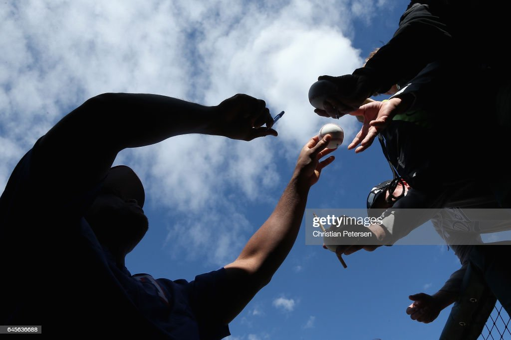 Adrian Beltre #29 of the Texas Rangers signs autographs for fans before the spring training game against the Kansas City Royals at Surprise Stadium on February 26, 2017 in Surprise, Arizona.