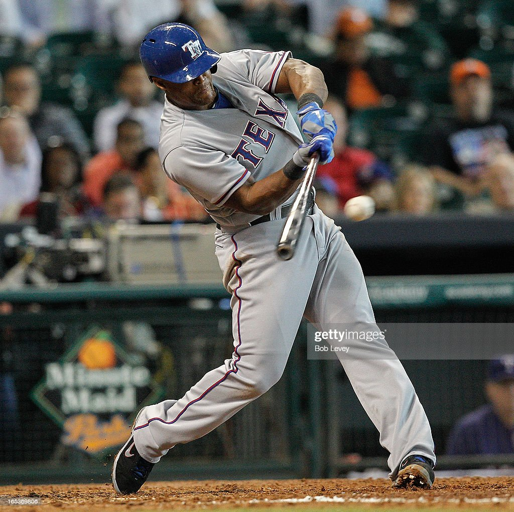 Adrian Beltre #29 of the Texas Rangers singles to center in the sixth inning against the Houston Astros at Minute Maid Park on April 3, 2013 in Houston, Texas.