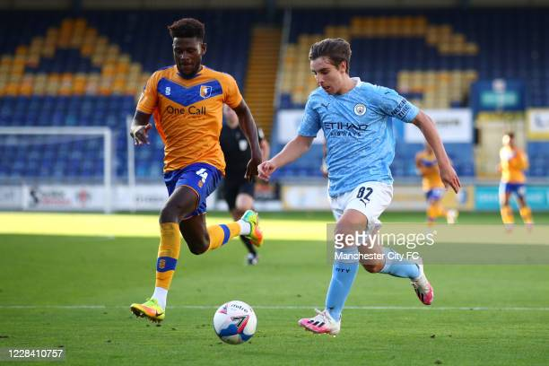 Adrian Bernabe of Manchester City in action with Rollin Menayese of Mansfield Town during the EFL Trophy match between Mansfield Town and Manchester...
