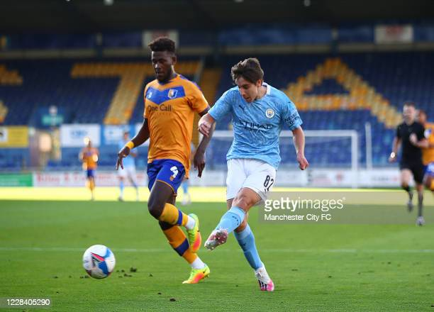 Adrian Bernabe of Manchester City scores the opening goal during the EFL Trophy match between Mansfield Town and Manchester City U21 at One Call...
