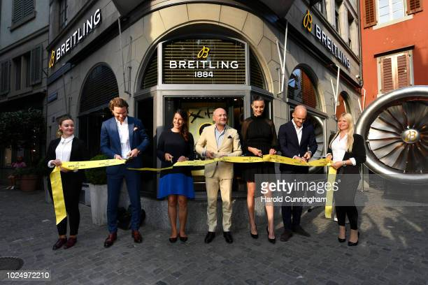 Adrian Bindella Dominique Gisin Breitling CEO Georges Kern Ronja Furrer and Steven Biedert cut the ribbon at the boutique opening of the Swiss luxury...