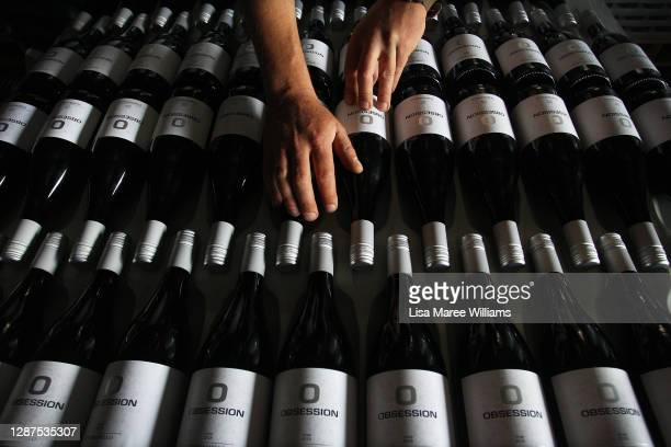 Adrian Brayne handles wine stock in the processing building at Obsession Wines on November 24, 2020 in Tumbarumba, Australia. Second-generation...