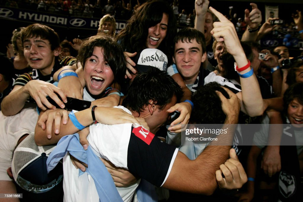 Adrian Caceres of the Victory celebrates with fans after Victory defeated United six nil at the Hyundai A-League Grand Final between the Melbourne Victory and Adelaide United at the Telstra Dome February 18, 2007 in Melbourne, Australia.