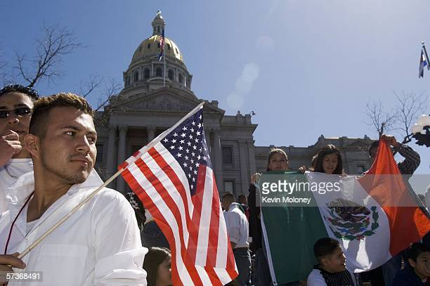 Adrian Campos holds a US flag during a rally with about 3000 middle and high school students who walked out of school April 19 2006 in Denver...