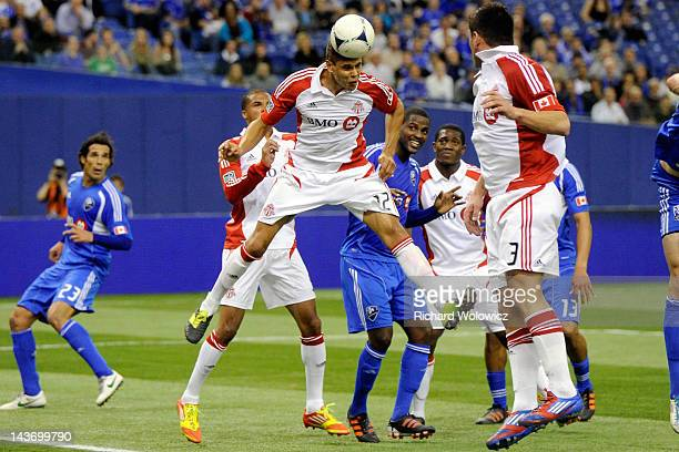 Adrian Cann of the Toronto FC jumps to head the ball during the Amway Canadian Championship Series match against the Montreal Impact at the Olympic...