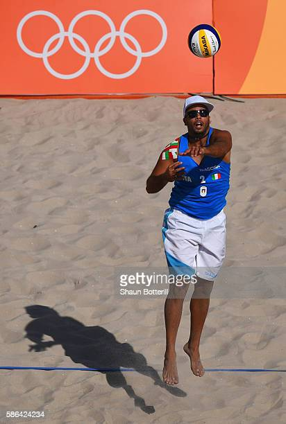 Adrian Carambula Raurich of Italy serves during the Men's Beach Volleyball preliminary round Pool A match against Clemens Doppler and Alexander Horst...