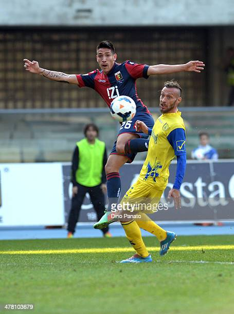 Adrian Centurion of Genoa CFC battles for the ball with Tiberio Guarente of Chievo Verona during the Serie A match between AC Chievo Verona and Genoa...