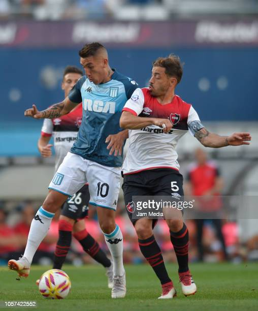 Adrian Centurion of Racing Club fights for the ball with Hernan Bernardello of Newell's Old Boys in action during a match between Racing Club and...
