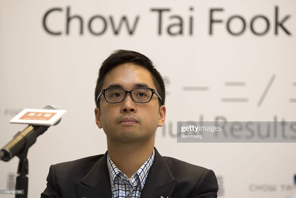 Adrian Cheng, executive director of Chow Tai Fook Jewellery Group Ltd., attends the companys annual results news conference in Hong Kong, China, on Tuesday, June 18, 2013. Chow Tai Fook, the worlds largest listed jewelry chain, reported a 13 percent decline in profit on higher costs and weaker consumer spending. Photographer: Jerome Favre/Bloomberg via Getty Images