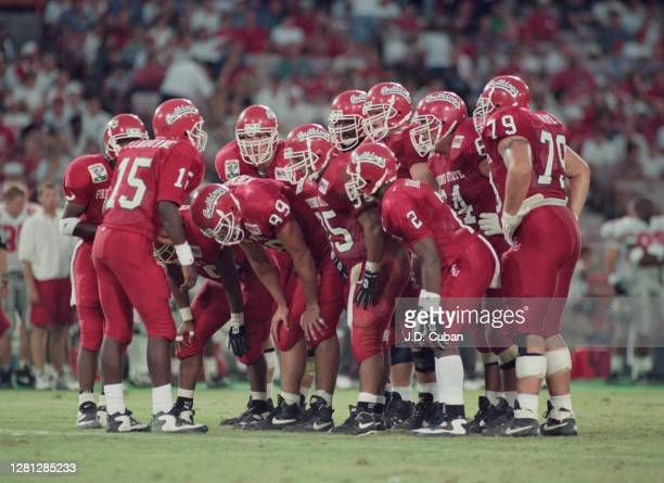 Adrian Claiborne Quarterback for the Fresno State Bulldogs instructs his offensive line in the huddle during the NCAA Big Ten Conference Disneyland...