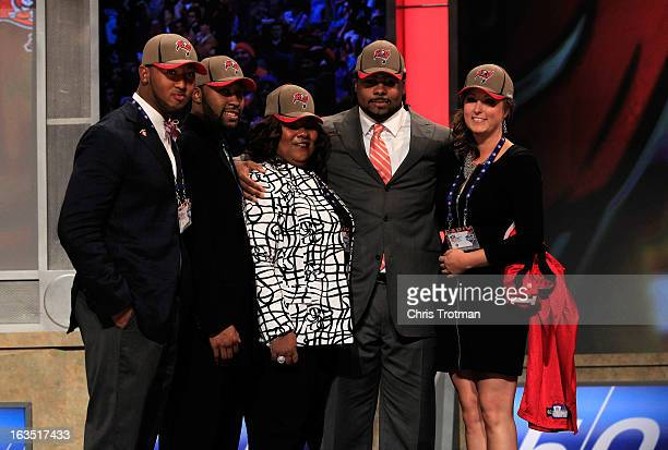 Adrian Clayborn, #20 overall pick by the Tampa Bay Buccaneers, poses with family on stage on stage during the 2011 NFL Draft at Radio City Music Hall...