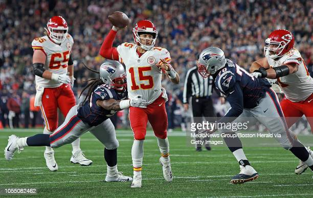 Adrian Clayborn and Adam Butler of the New England Patriots put the pressure on Patrick Mahomes of the Kansas City Chiefs during the second quarter...