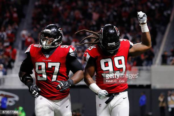 Adrian Clayborn of the Atlanta Falcons celebrates a sack during the second half against the Dallas Cowboys at Mercedes-Benz Stadium on November 12,...
