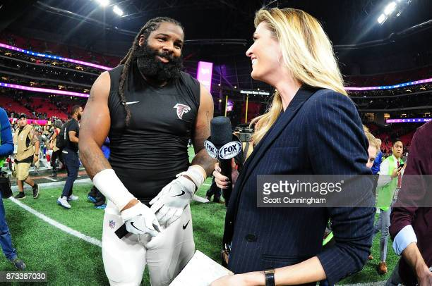 Adrian Clayborn of the Atlanta Falcons is interviewed by Erin Andrews of Fox Sports after the game against the Dallas Cowboys at MercedesBenz Stadium...