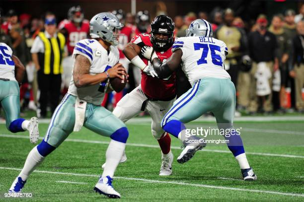 Adrian Clayborn of the Atlanta Falcons rushes past Byron Bell of the Dallas Cowboys at MercedesBenz Stadium on November 12 2017 in Atlanta Georgia