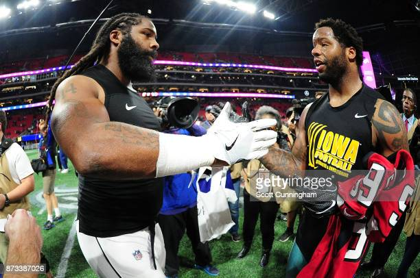 Adrian Clayborn of the Atlanta Falcons shakes hands with Anthony Hitchens of the Dallas Cowboys after the game at MercedesBenz Stadium on November 12...