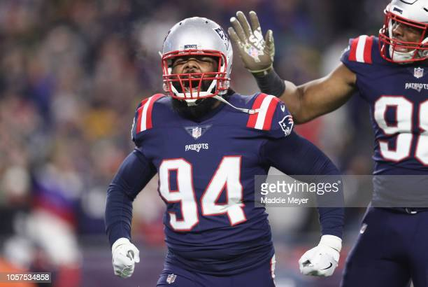 Adrian Clayborn of the New England Patriots celebrates after sacking Aaron Rodgers of the Green Bay Packers during the second half at Gillette...