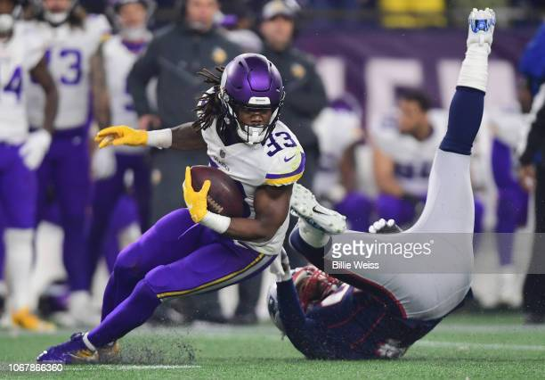 Adrian Clayborn of the New England Patriots is unable to tackle Dalvin Cook of the Minnesota Vikings during the fourth quarter at Gillette Stadium on...