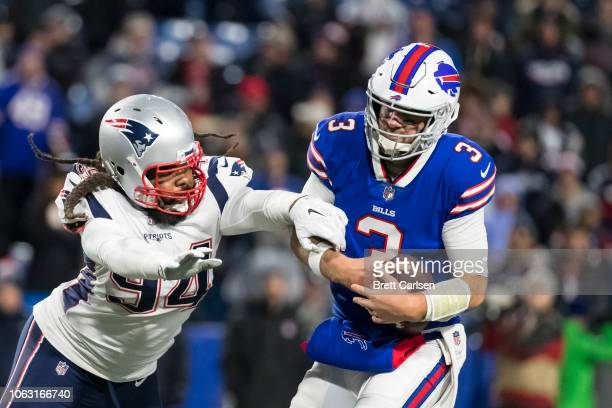 Adrian Clayborn of the New England Patriots sacks Derek Anderson of the Buffalo Bills during the fourth quarter at New Era Field on October 29 2018...