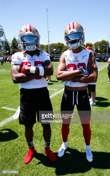Adrian Colbert and Ahkello Witherspoon of the San Francisco 49ers stand on the field during the team Mini Camp at the SAP Training Facility on June...