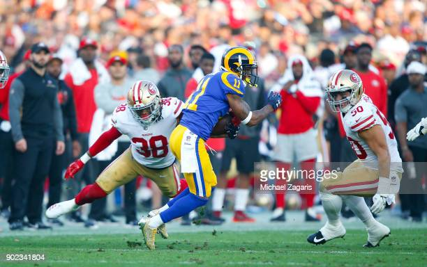 Adrian Colbert and Brock Coyle of the San Francisco 49ers close in on Tavon Austin of the Los Angeles Rams during the game at Los Angeles Memorial...