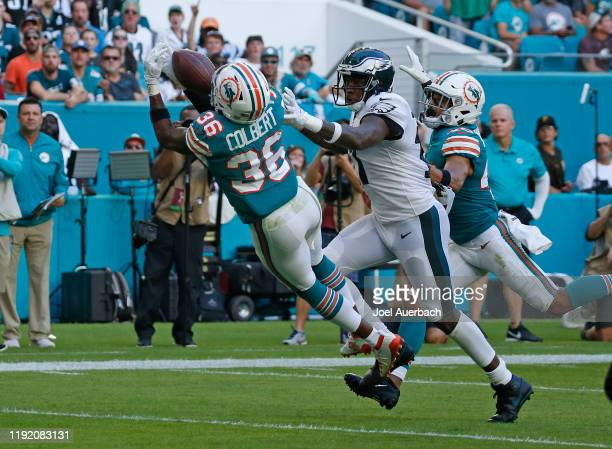 Adrian Colbert of the Miami Dolphins is unable to catch the ball while being defended by Alshon Jeffery of the Philadelphia Eagles during an NFL game...