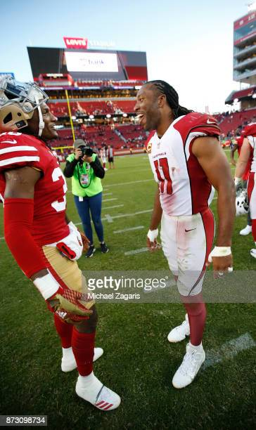 Adrian Colbert of the San Francisco 49ers and Larry Fitzgerald of the Arizona Cardinals talk on the field following the game at Levi's Stadium on...