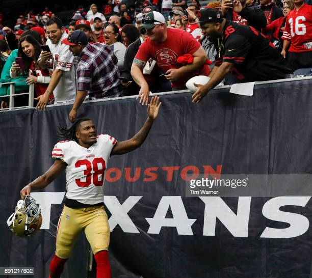 Adrian Colbert of the San Francisco 49ers celebrates with fans after the game against the Houston Texans at NRG Stadium on December 10 2017 in...