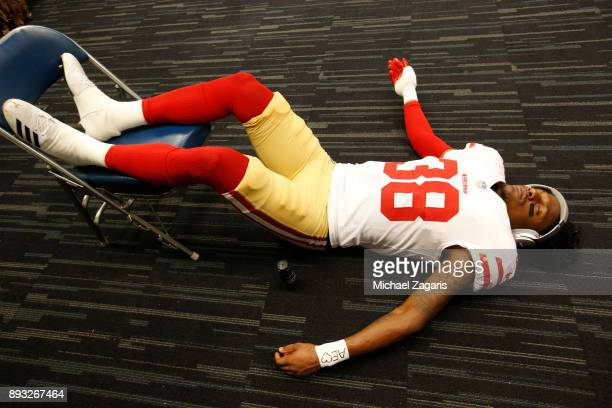 Adrian Colbert of the San Francisco 49ers listens to music in the locker room prior to the game against the Houston Texans at NRG Stadium on December...